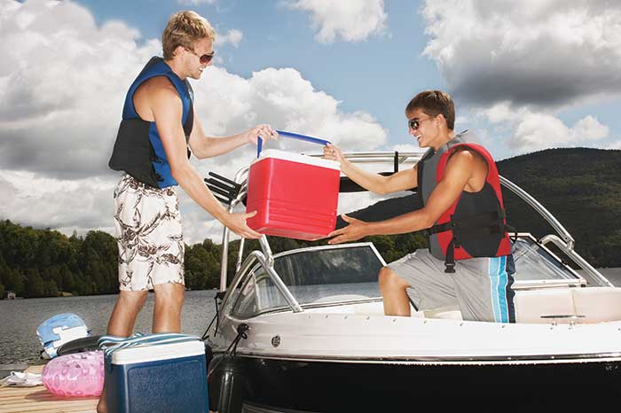 Loading a cooler on boat