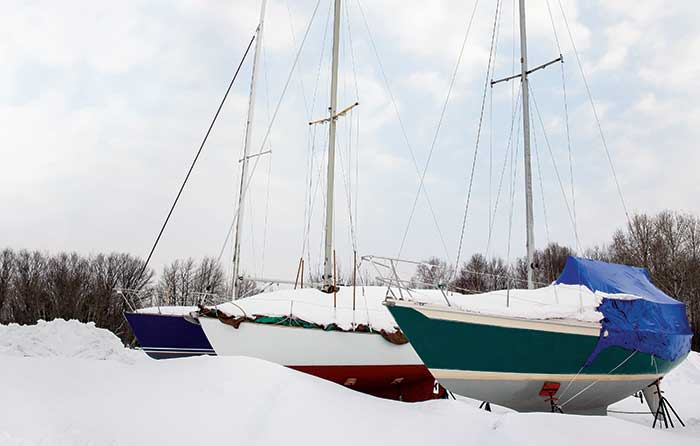 Snow-covered boats